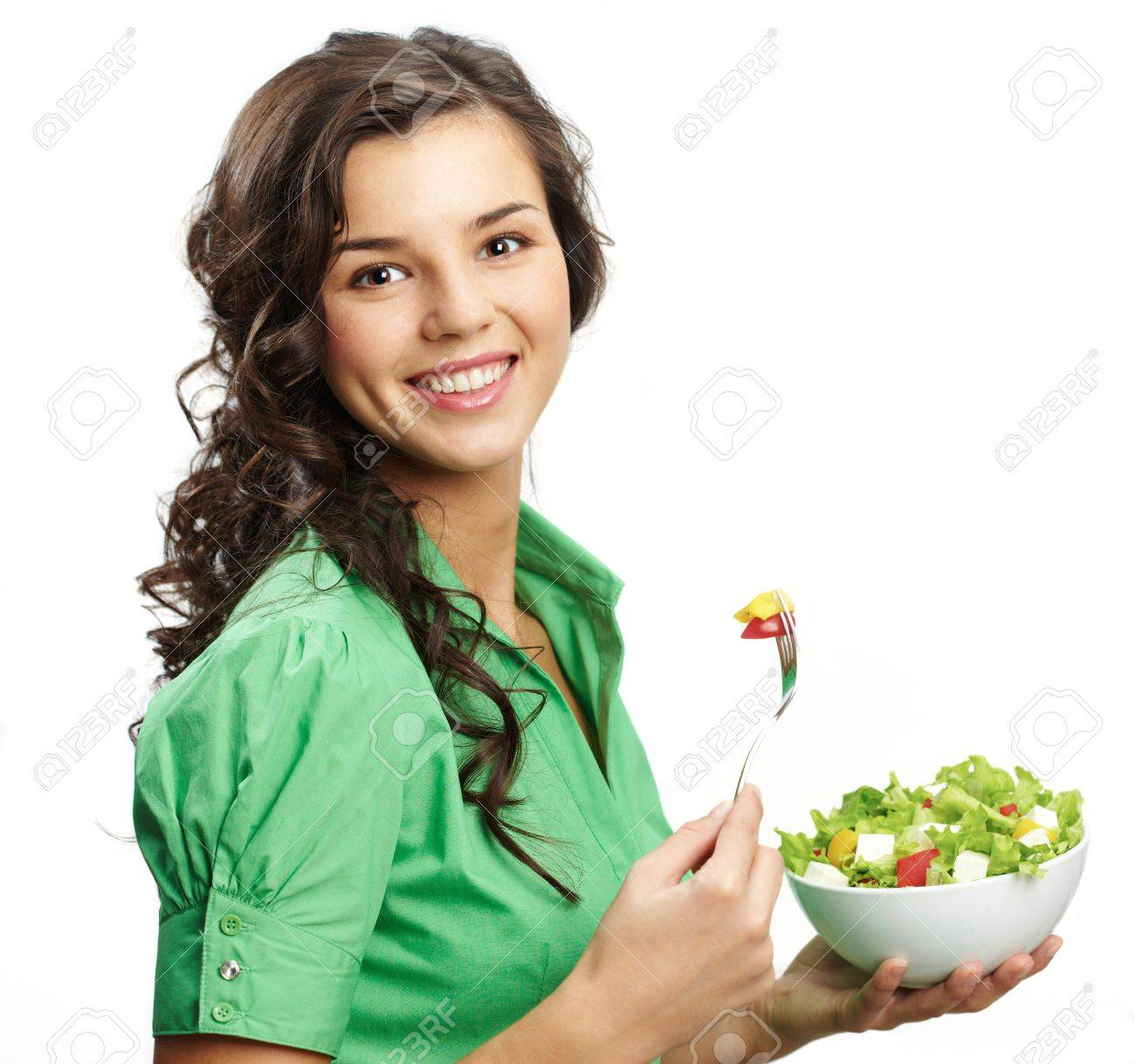 Portrait of a girl with bawl of salad looking at camera Stock Photo - 8227389