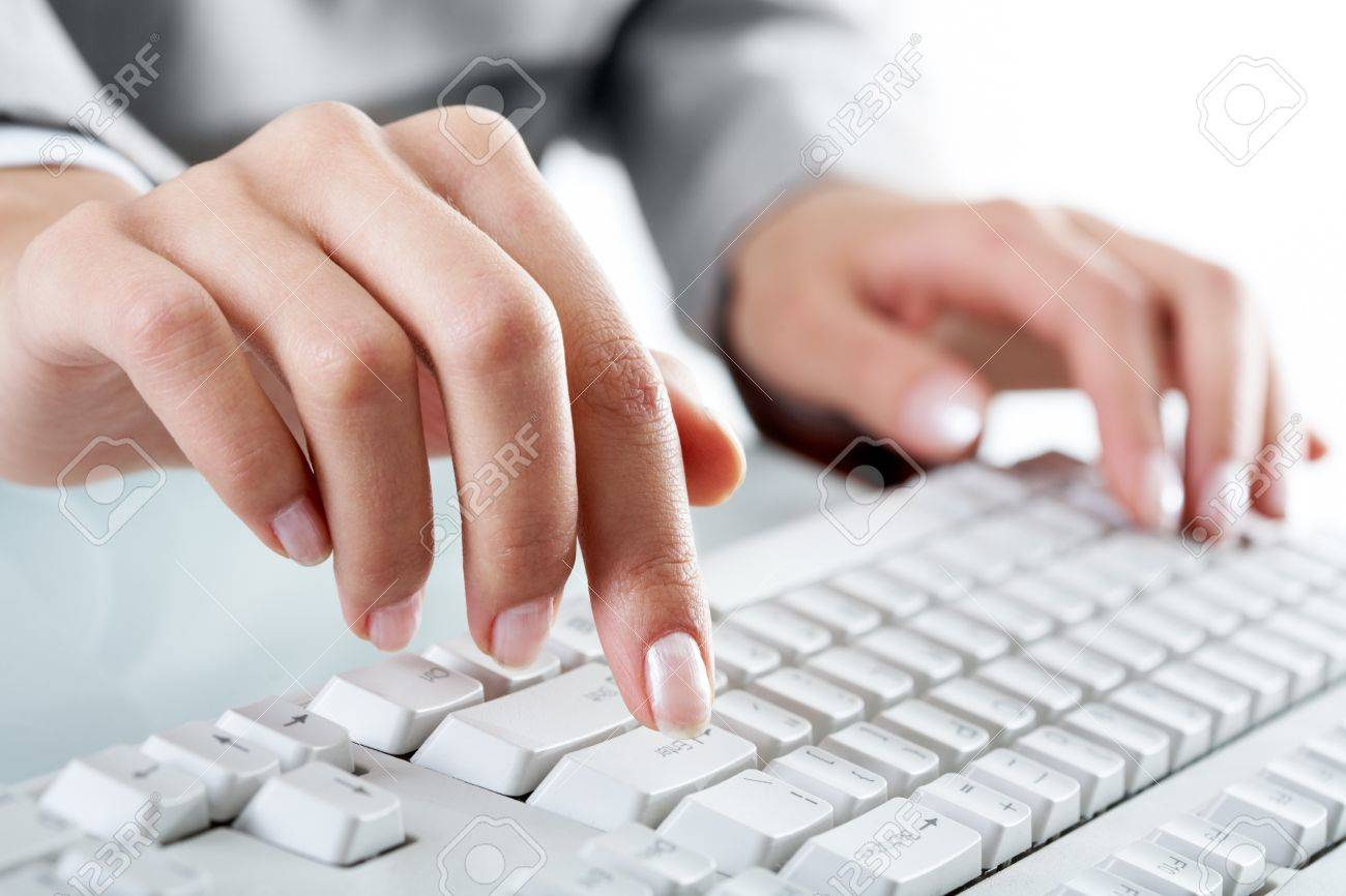 Macro image of human hand with forefinger going to press key on keyboard Stock Photo - 8228610