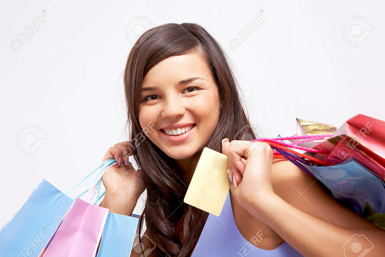 Portrait of happy girl with colorful paper bags and plastic card looking at camera Stock Photo - 8229346