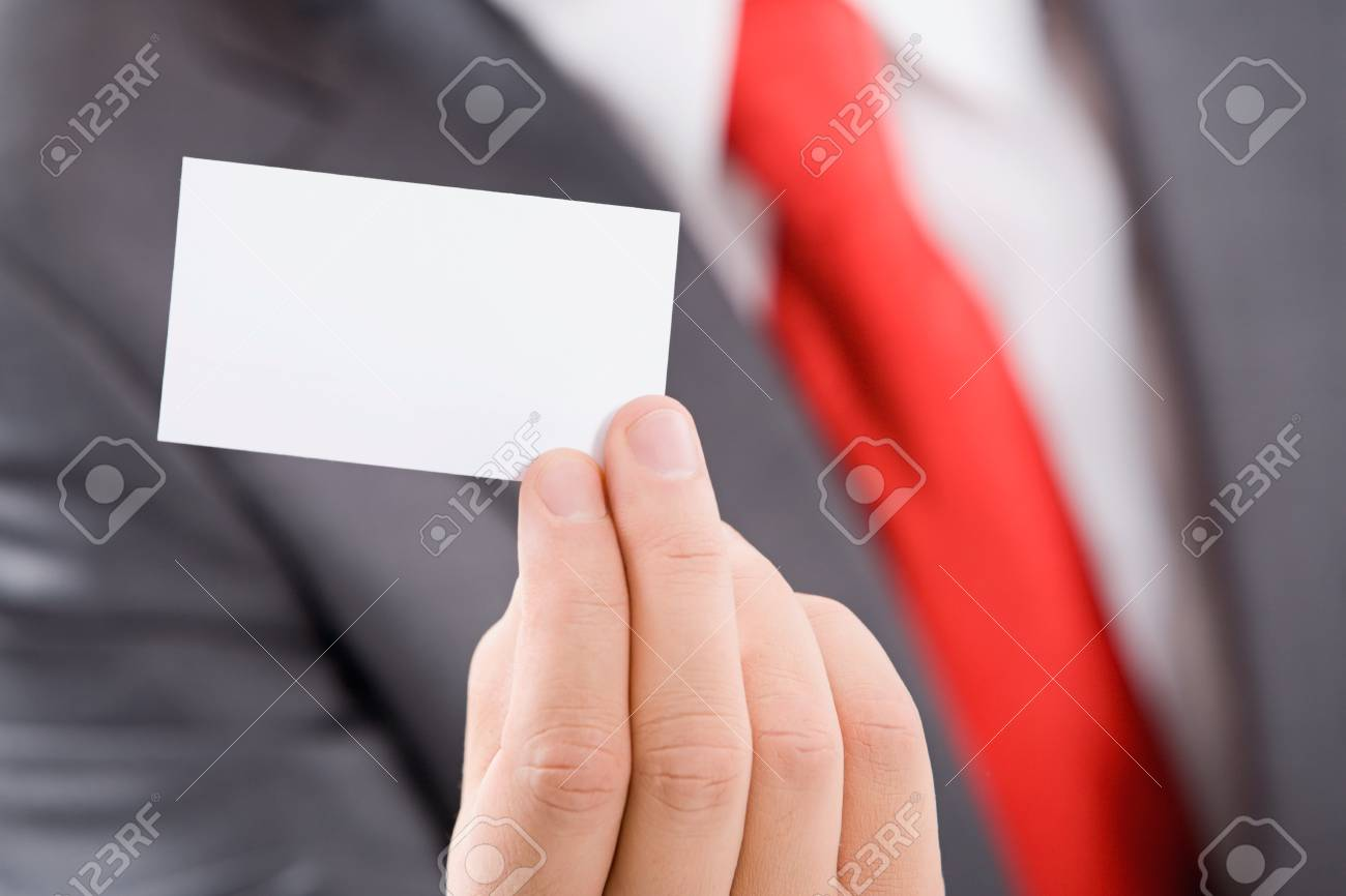 Close-up of male hand holding a business card Stock Photo - 8313133
