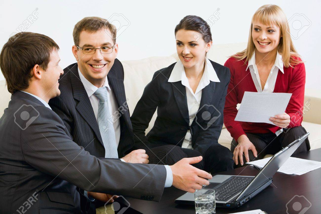 Four successful people gathered together for brainstorming Stock Photo - 8393945