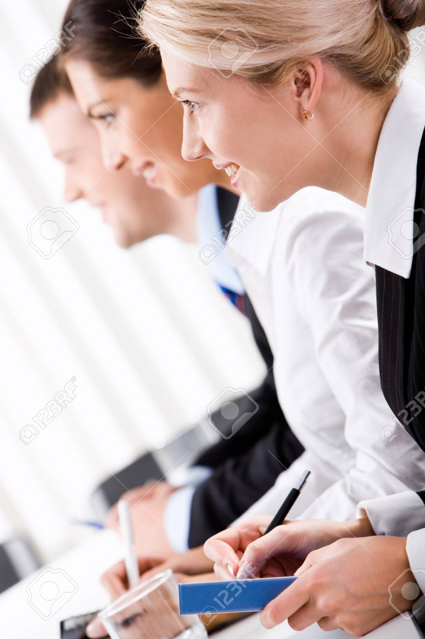 Row of successful young professional at a seminar Stock Photo - 8393600