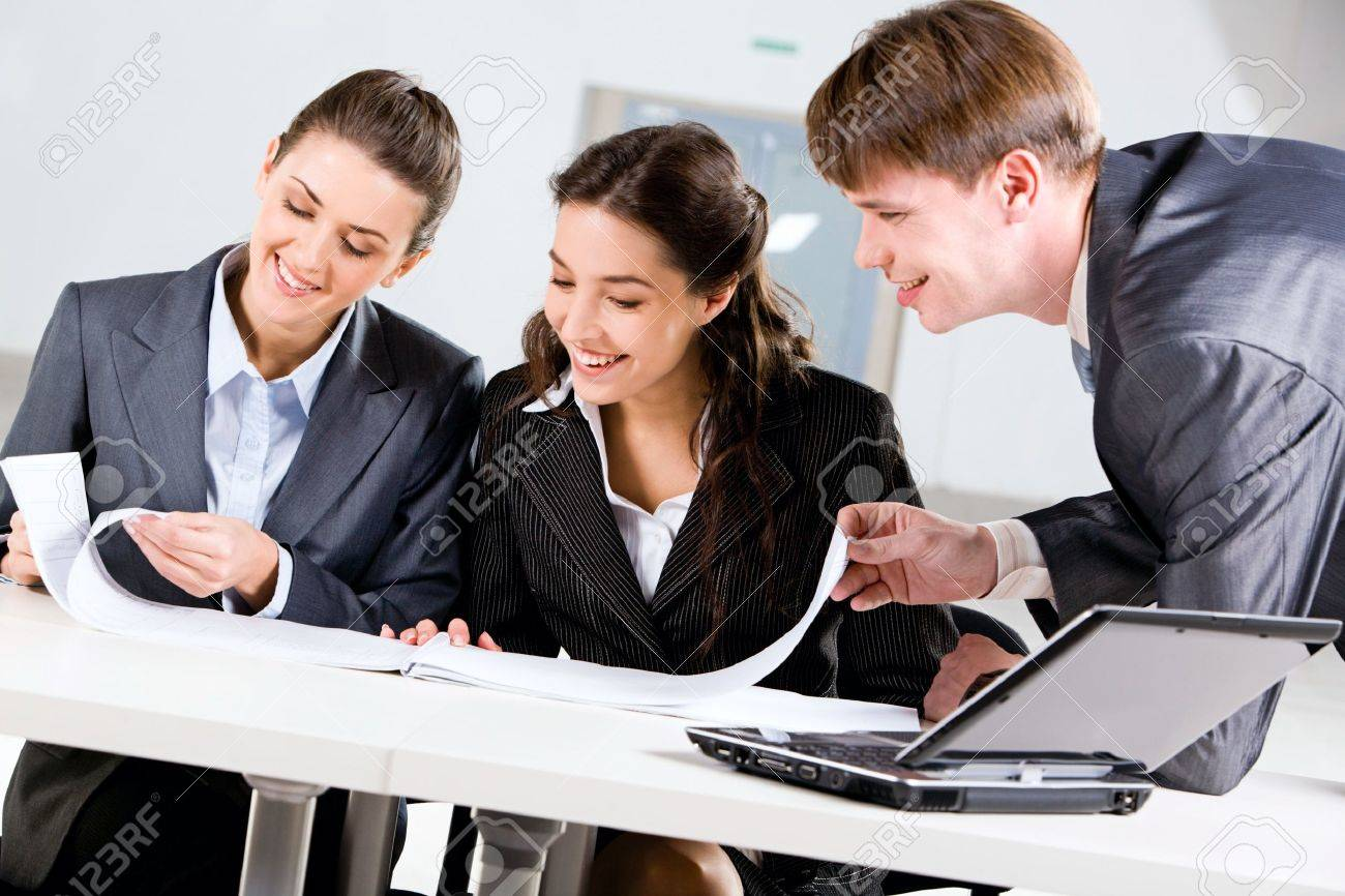 Portrait of three people working together in the office Stock Photo - 8394693