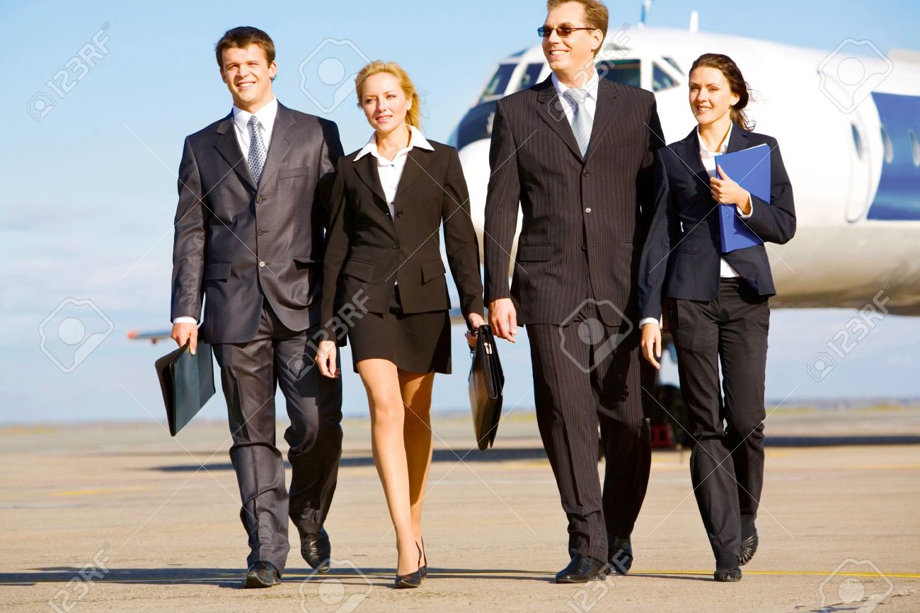 Group of successful people walking on the background of the airplane Stock Photo - 8394734