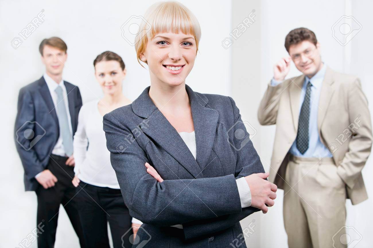 Photo of beautiful female leader on the background of her business team Stock Photo - 8400125