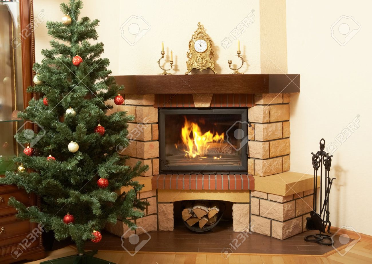image of house room with christmas tree and fireplace in it stock