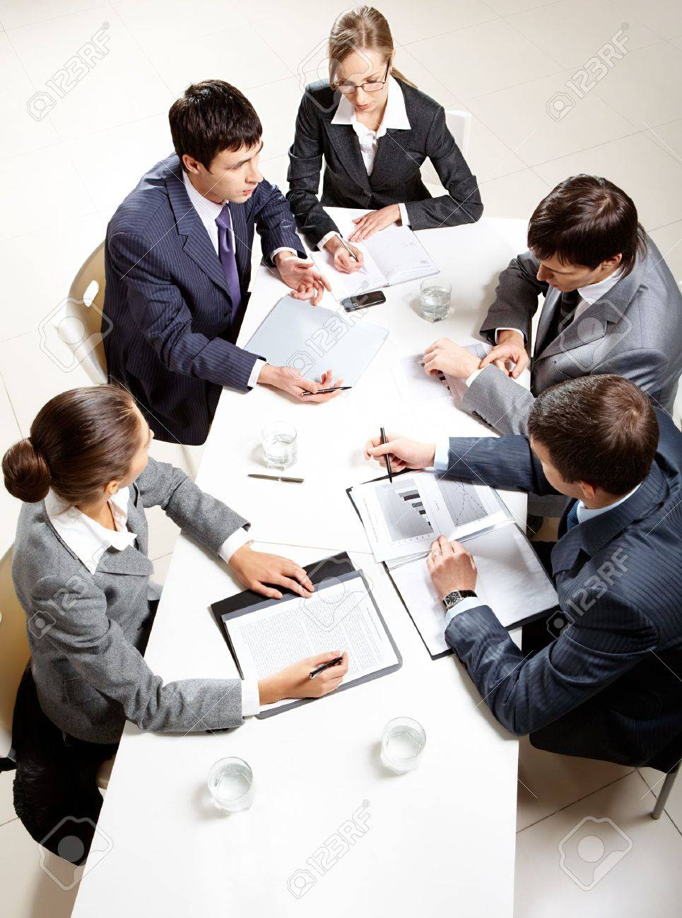 Team of five business people discussing an important question at briefing Stock Photo - 8402629
