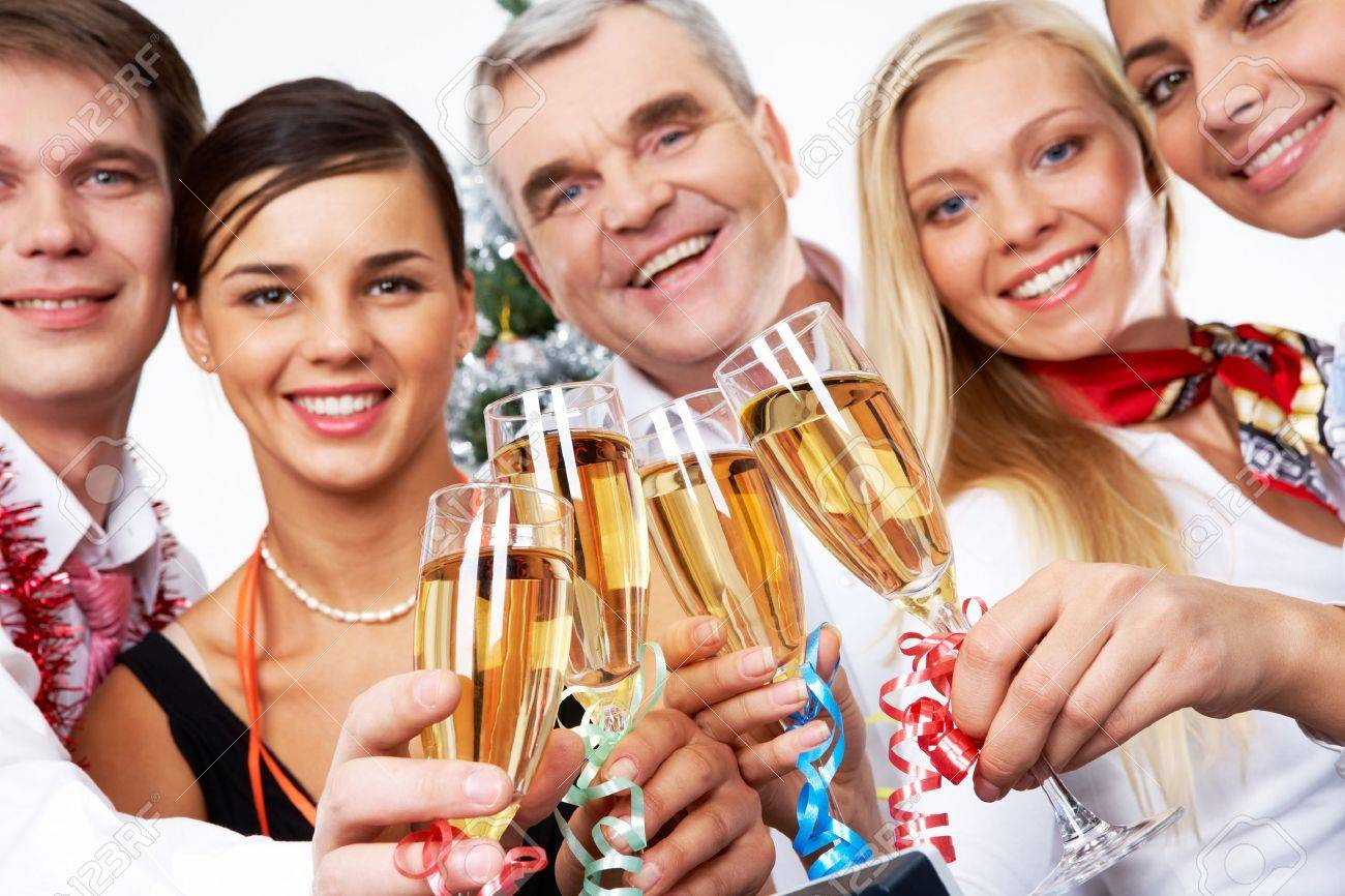 Image of crystal glasses full of champagne held by successful companions Stock Photo - 8405298