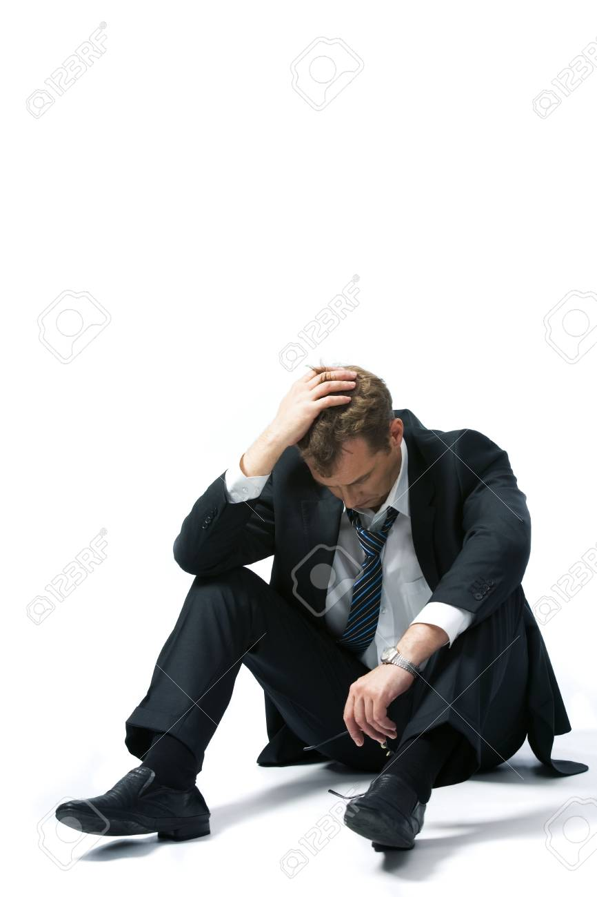 Portrait of stressed businessman touching his head and thinking about future Stock Photo - 8454969