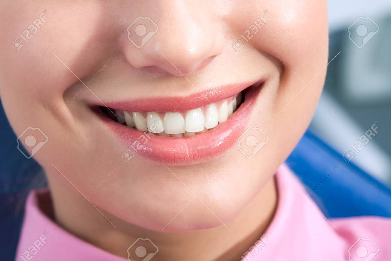 Close-up of happy female smile and healthy teeth Stock Photo - 8455060