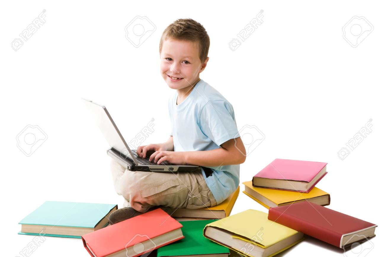 Smart boy typing on laptop and looking at camera over white background Stock Photo - 8493783