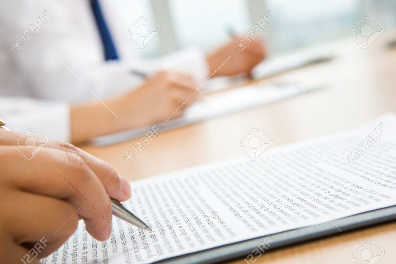 Image of human hand holding pen and making notes Stock Photo - 8506418