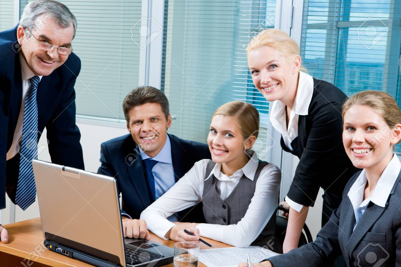 Portrait of confident co-workers looking at camera with smiles Stock Photo - 8507946
