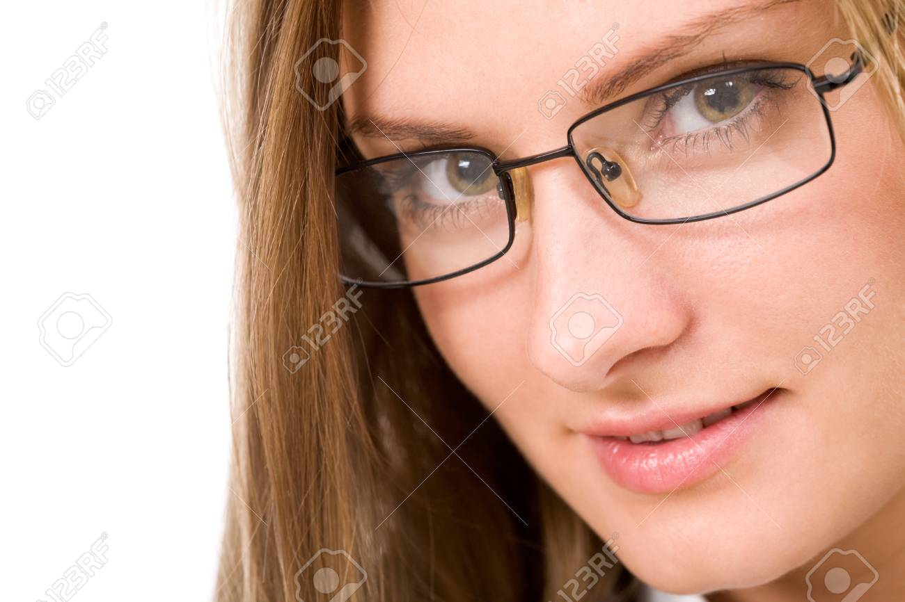 Close-up of charming woman in eyeglasses looking at camera Stock Photo - 8508055