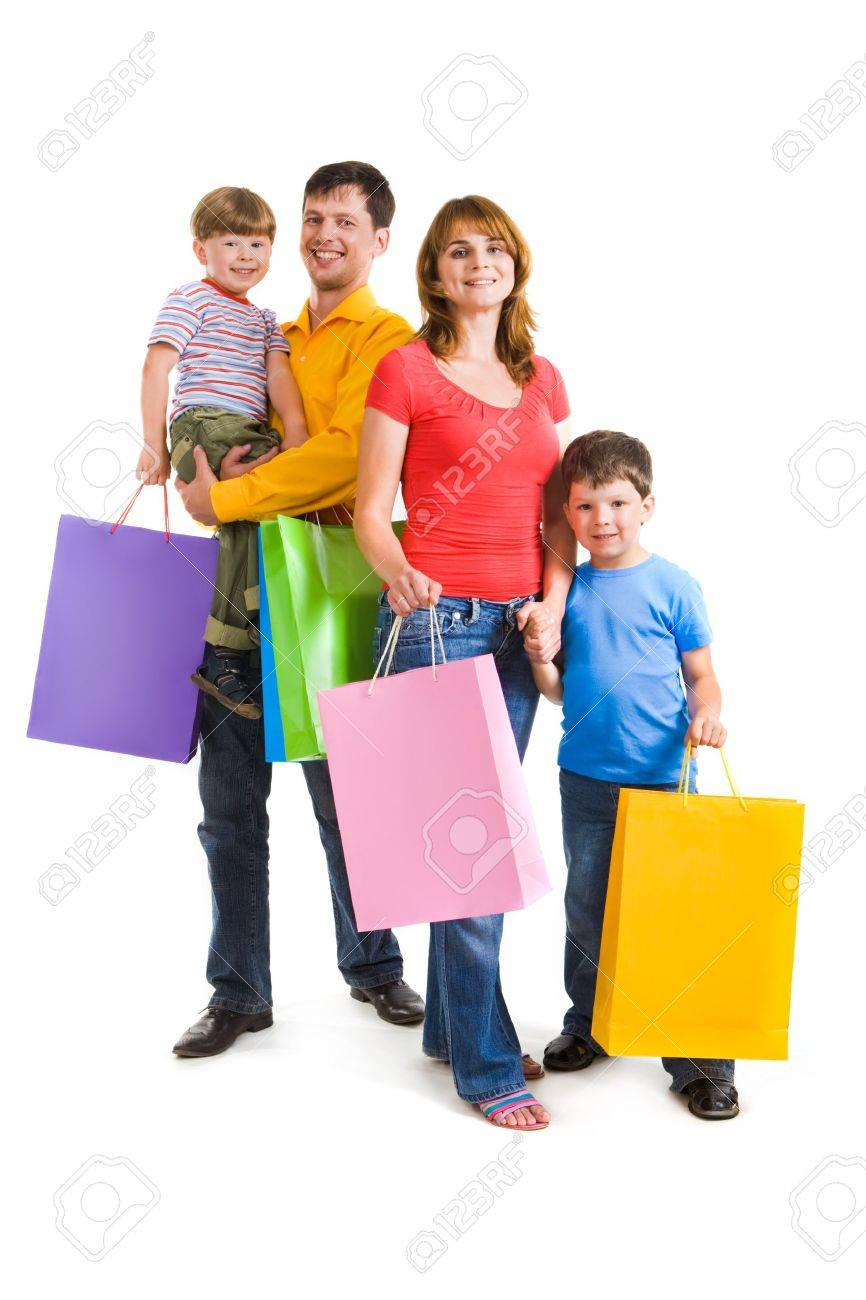 Portrait of happy family standing and holding bags while looking at camera with smiles Stock Photo - 8508234