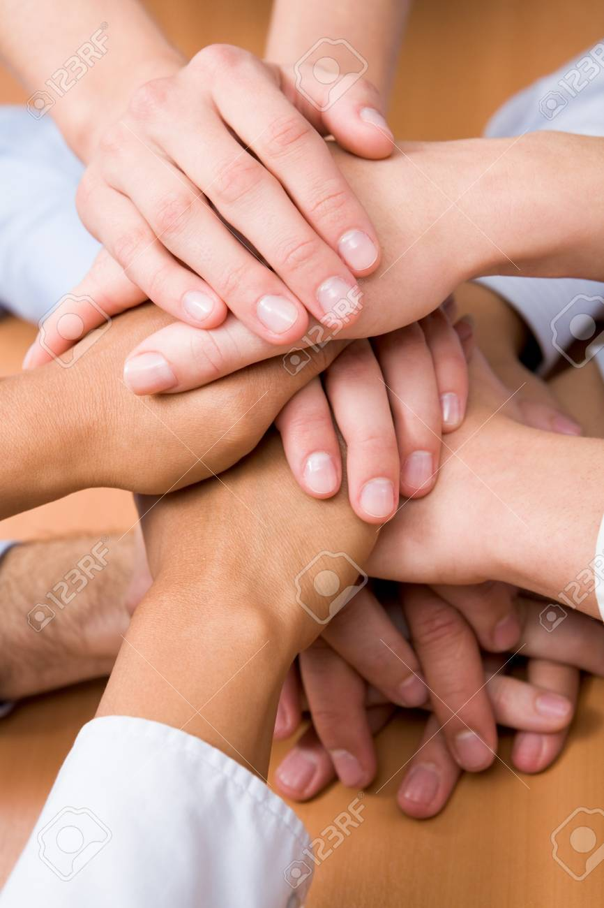 Image of business partners hands on top of each other Stock Photo - 8523705
