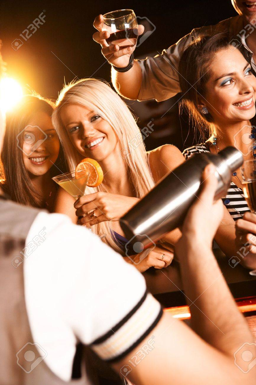 Photo of pretty girls toasting and looking at barman Stock Photo - 8528330
