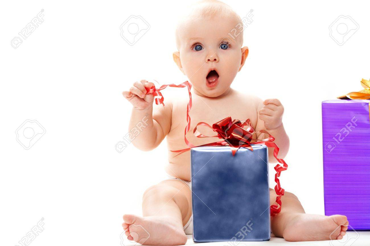 Surprised baby sitting with big giftbox by her side over white background Stock Photo - 8531034