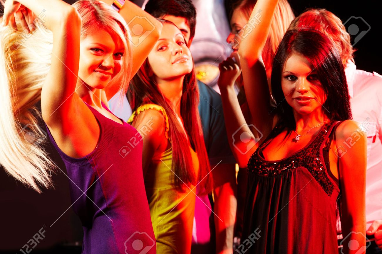 Group of fashionable girls dancing in the night club Stock Photo - 8529163