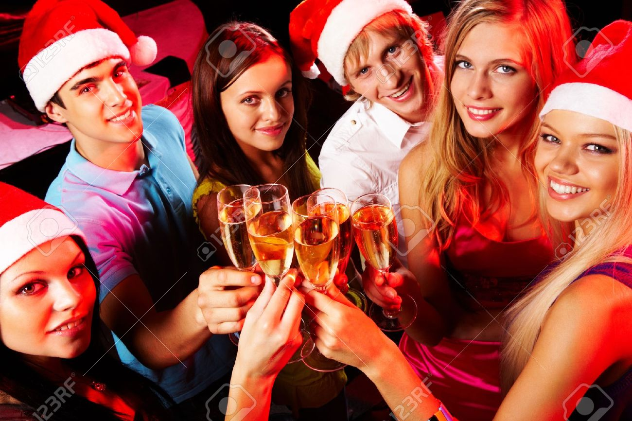 Above angle of young people enjoying themselves at Christmas party Stock Photo - 8528245