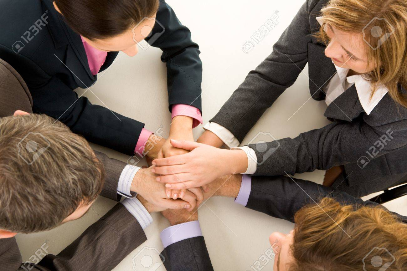 Image of business people keeping hands on top of each other at workplace Stock Photo - 8538832