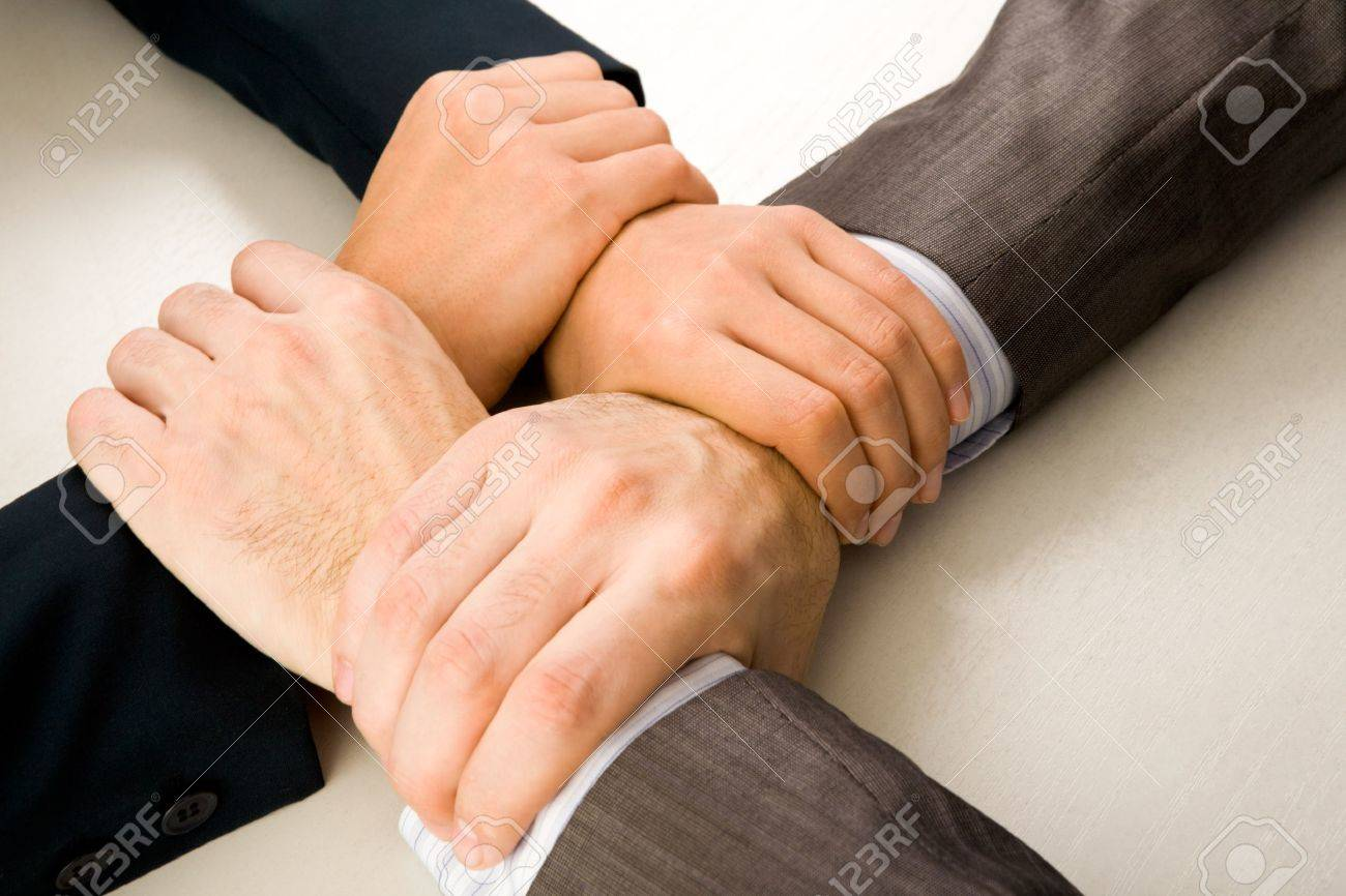 Image of crossed hands of business partners Stock Photo - 8527911