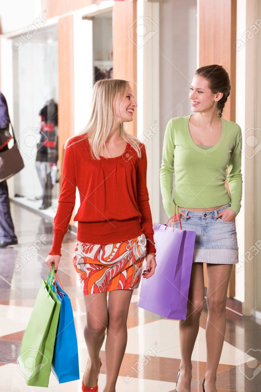 Photo of happy girls walking down trade center and chatting Stock Photo - 9163429