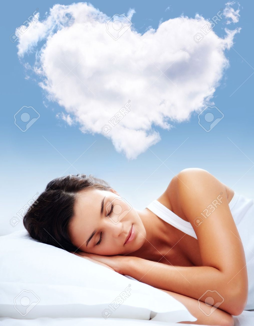 Portrait of a young girl sleeping on a pillow with heartshaped cloud over her Stock Photo - 9262248