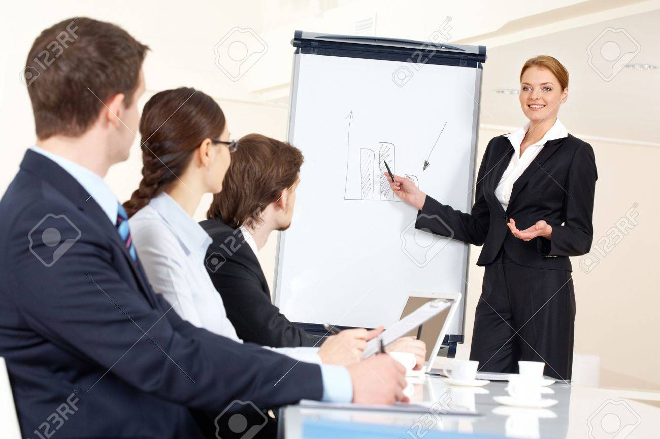 Smart And Confident Employee Pointing At Whiteboard While ...