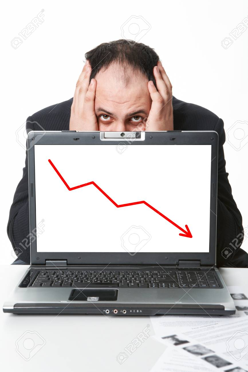 Photo of middle aged employer hiding behind laptop with falling graph on its screen Stock Photo - 9263126