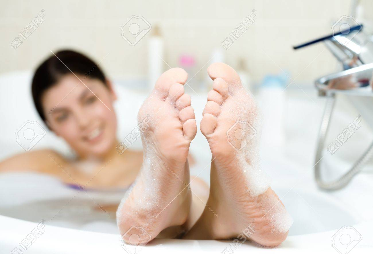 Image of soles of woman having pleasant bath with foam Stock Photo - 9298440