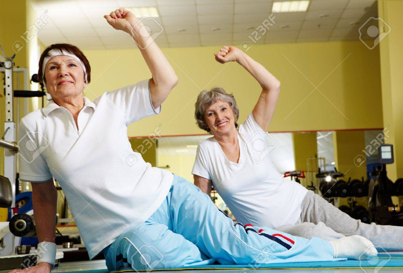 Portrait of sporty females doing physical exercise in sport gym Stock Photo - 9298487