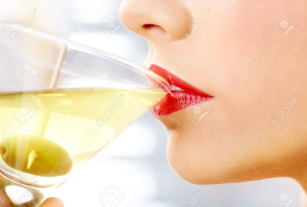 4bd93defac3b Close-up of woman drinking martini with olive Stock Photo - 9360202