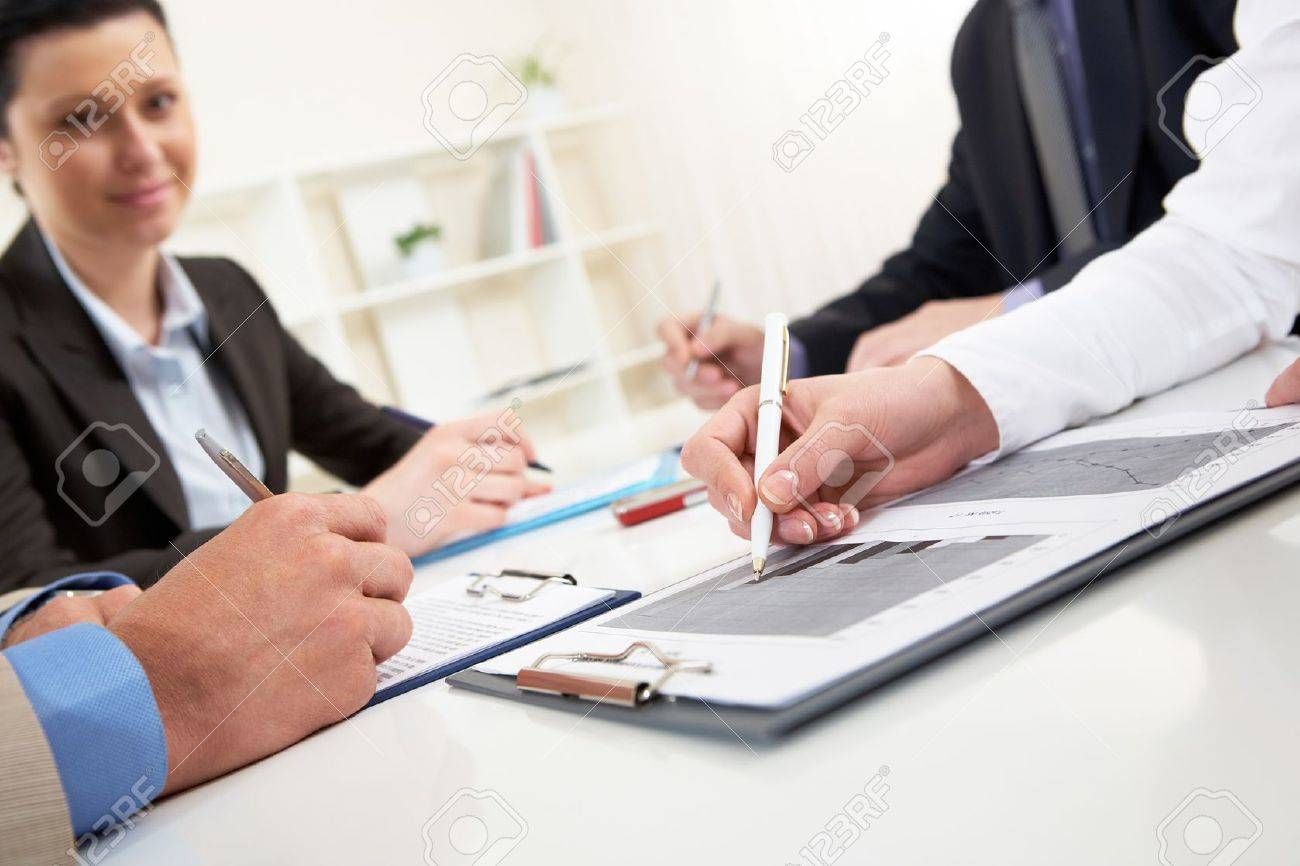 Close-up of business person hand over document in working environment Stock Photo - 9537324