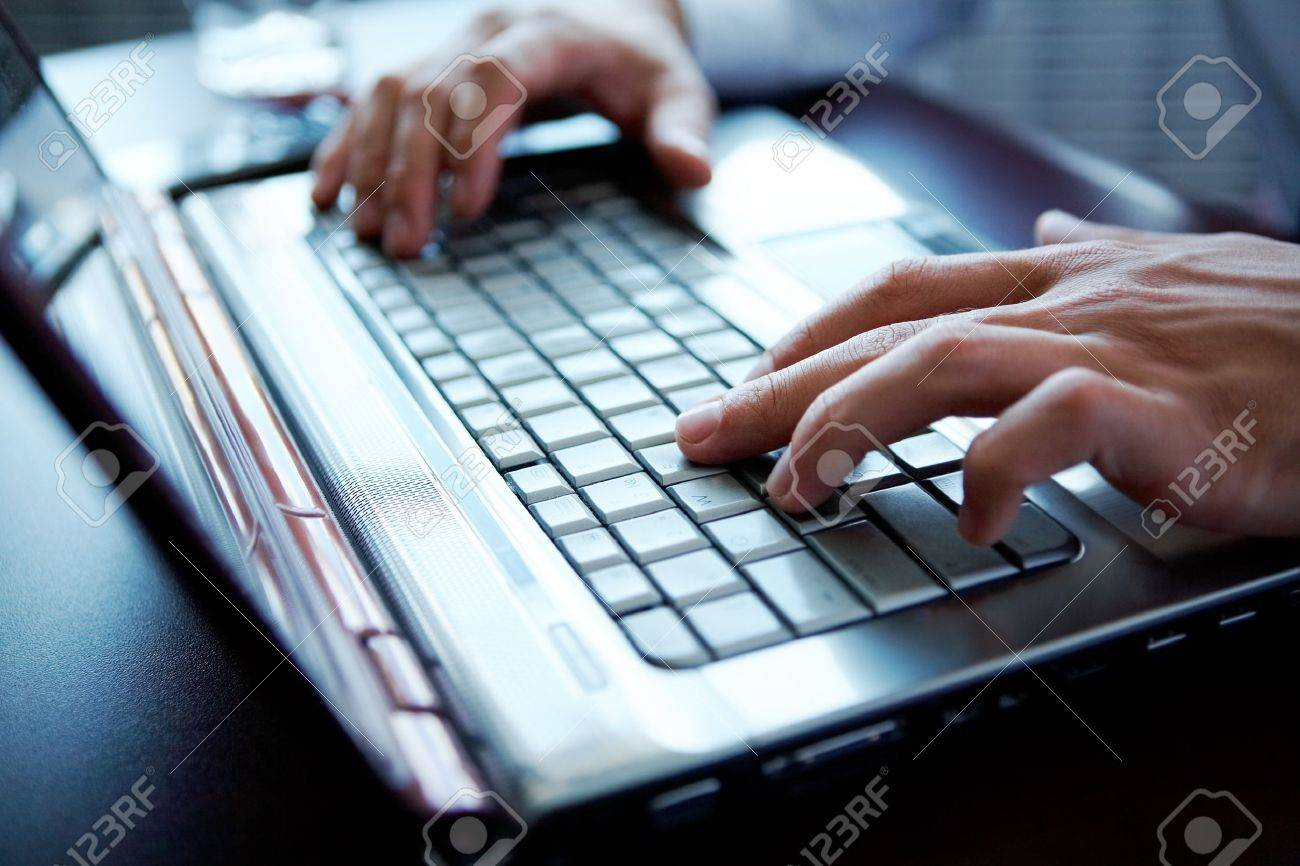 Hands of a man working with computer Stock Photo - 9571893