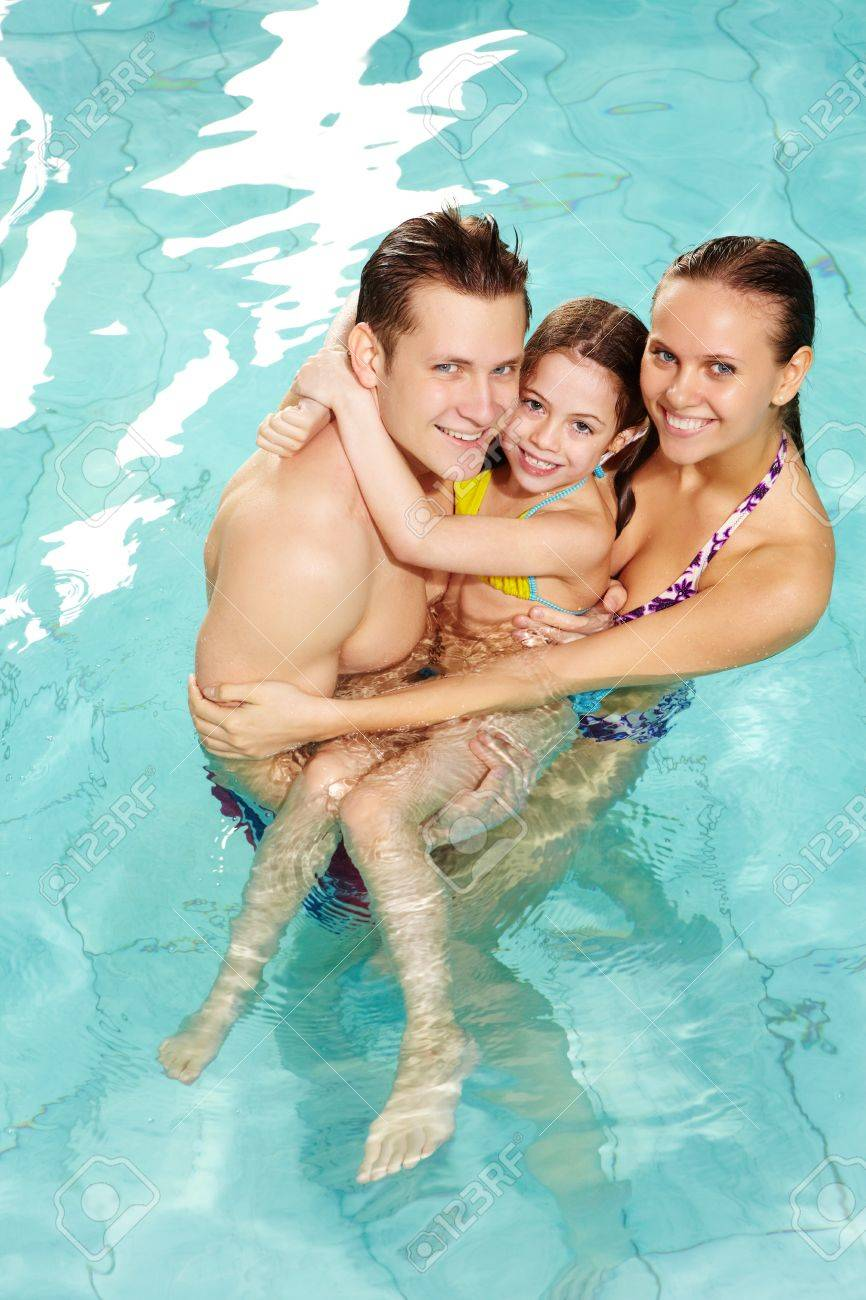Photo of happy family of parents and cute daughter in swimming pool Stock Photo - 9572053
