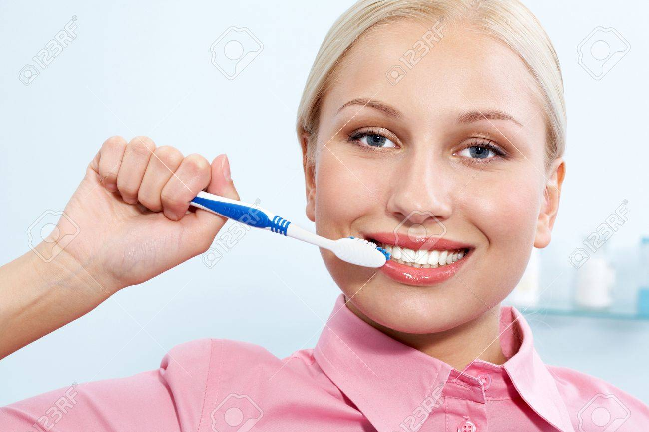 Image of happy female holding toothbrush in hand before cleaning teeth Stock Photo - 9675023