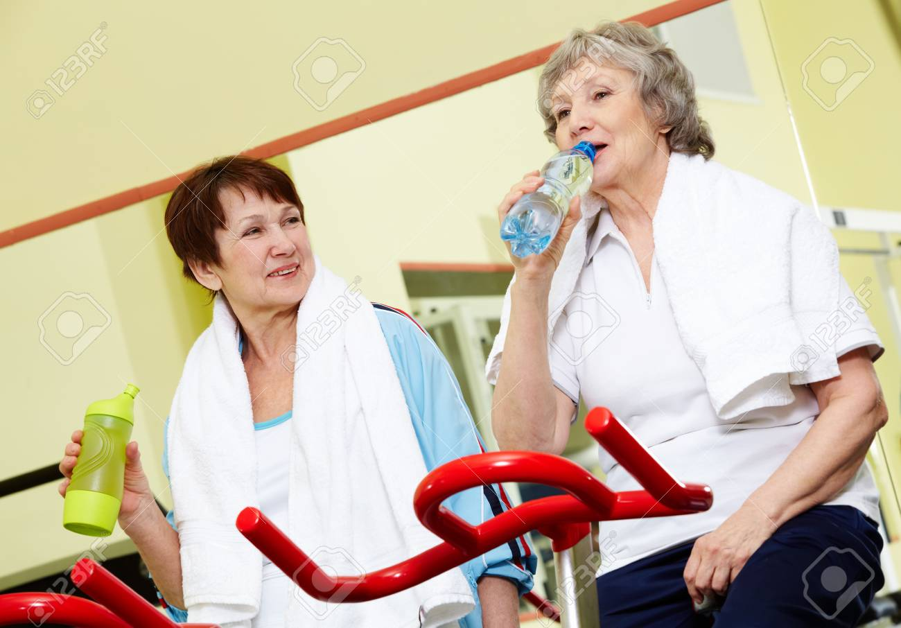 Portrait of senior females refreshing after workout in gym Stock Photo - 9675298