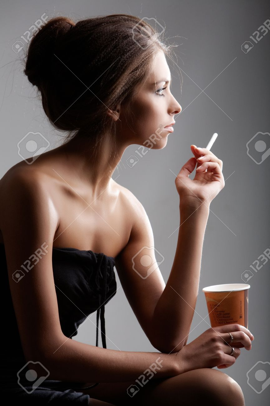 Portrait of elegant female smoking with plastic glass in hand Stock Photo - 9725162
