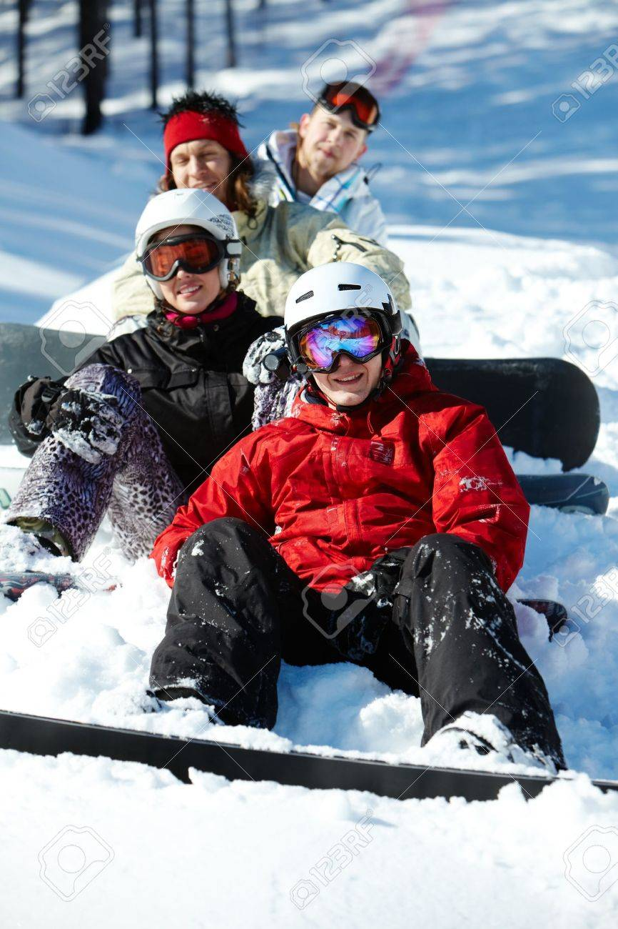 Portrait of happy friends snowboarding during winter vacations Stock Photo - 9725481
