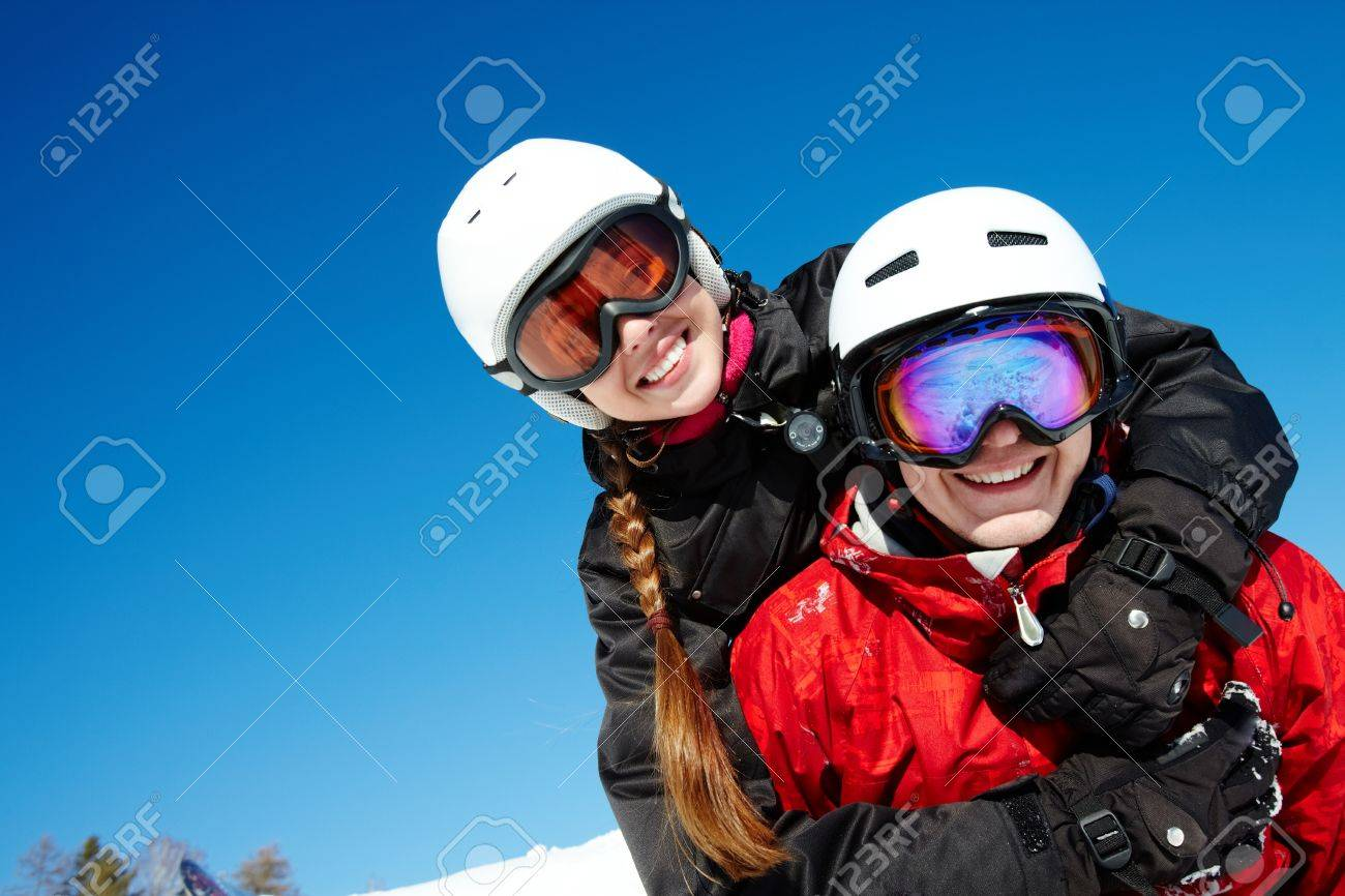 Portrait of happy couple of snowboarders outside during winter vacations Stock Photo - 9725571