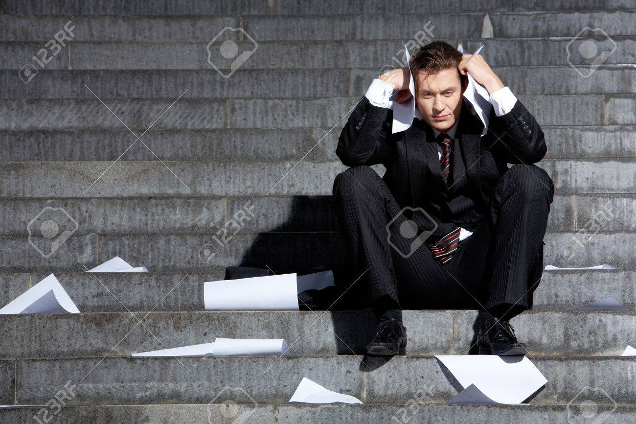 Portrait of unhappy businessman under depression touching his head in grief Stock Photo - 9725484