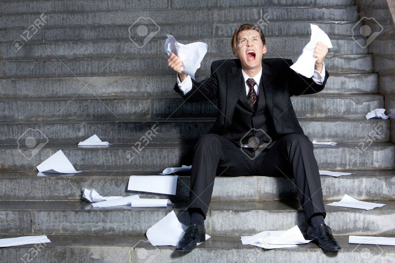 Image of grieving businessman crying with papers in hands Stock Photo - 9725538