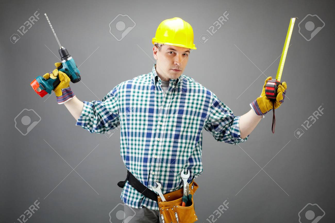 Portrait of architect worker with electric drill and measuring tape Stock Photo - 9725492