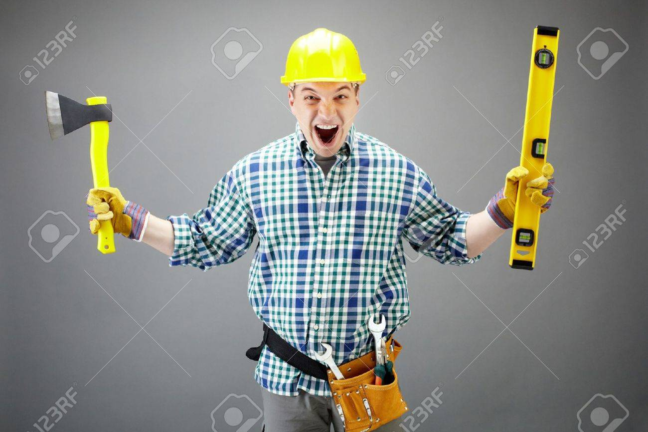 Portrait of crazy architect worker with axe and level measuring device Stock Photo - 9725500