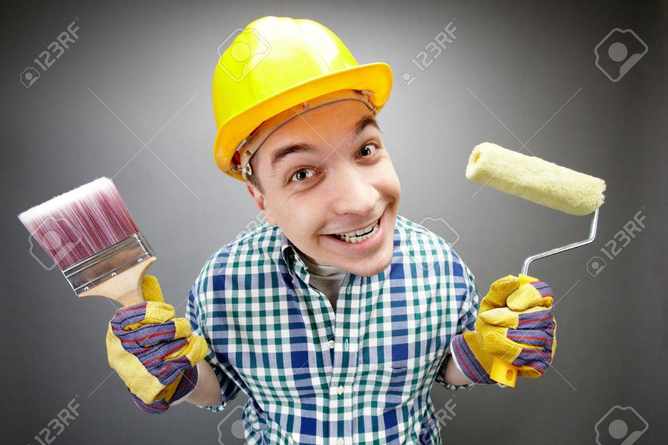 Portrait of smiling painter with paintbrush and roller Stock Photo - 9725244