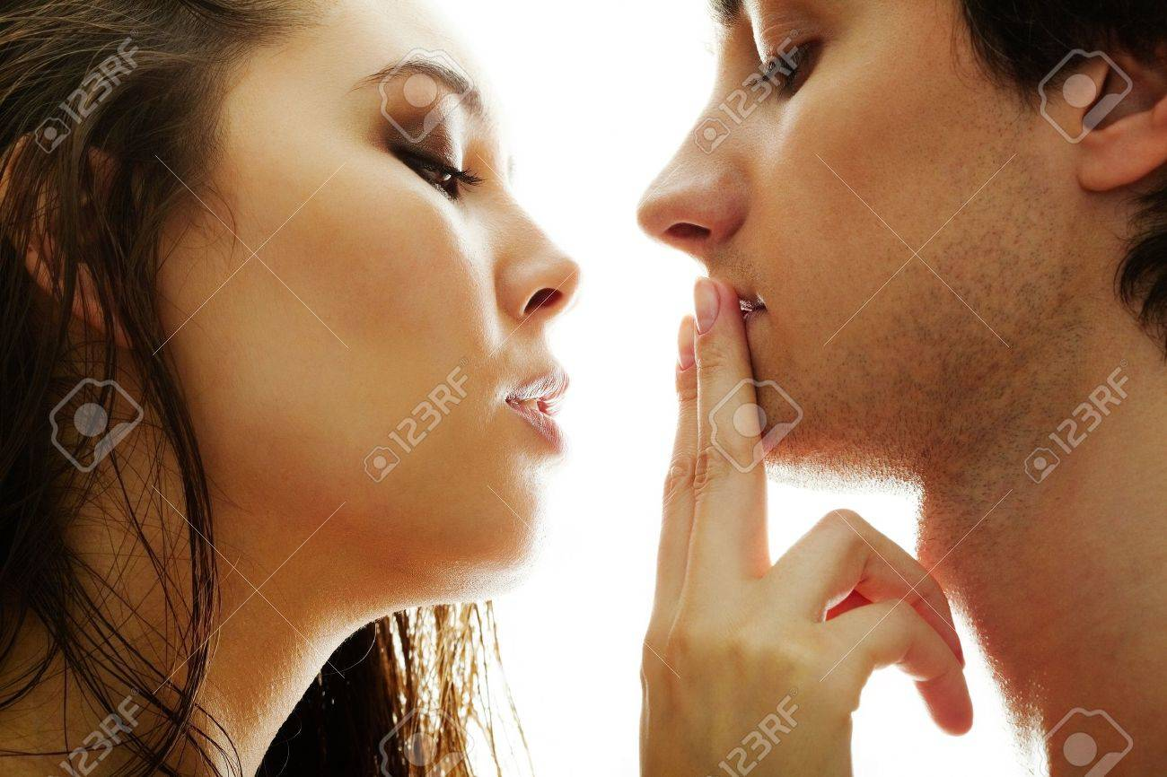 Pretty brunette touching male lips by her fingers Stock Photo - 9725808