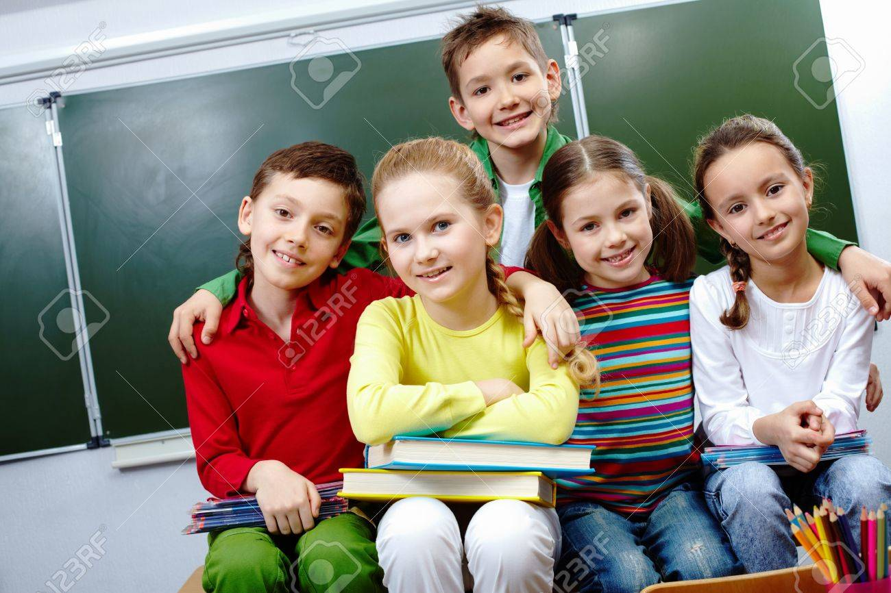 Portrait of happy guys and girls looking at camera in class Stock Photo - 9725833