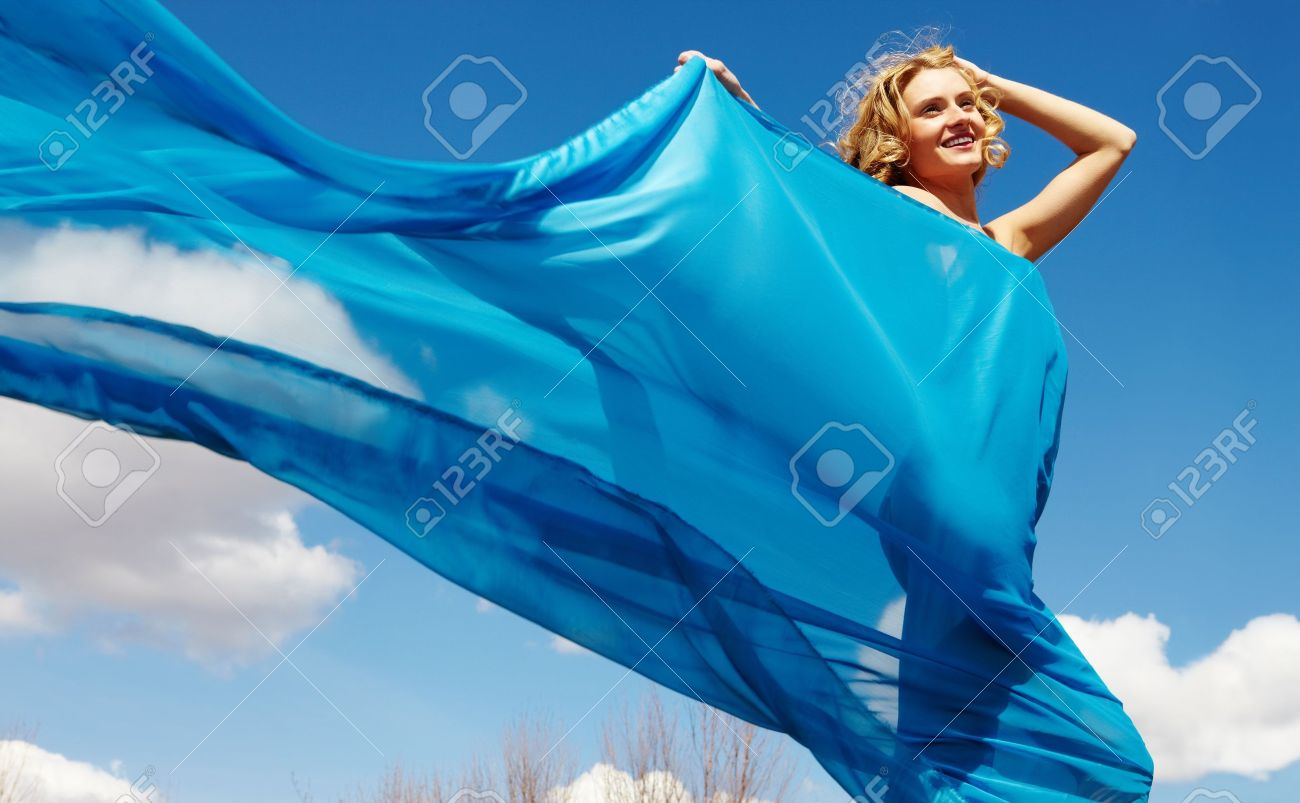 A young beautiful girl walking wrapped in blue silk drapery Stock Photo - 9725938