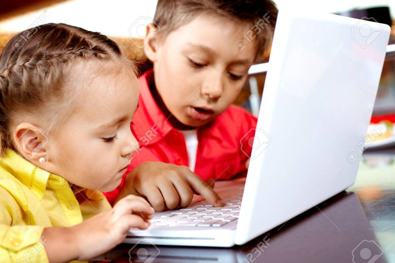 Worksheet Typing For Kid portrait of cute children typing on laptop stock photo picture 9726246